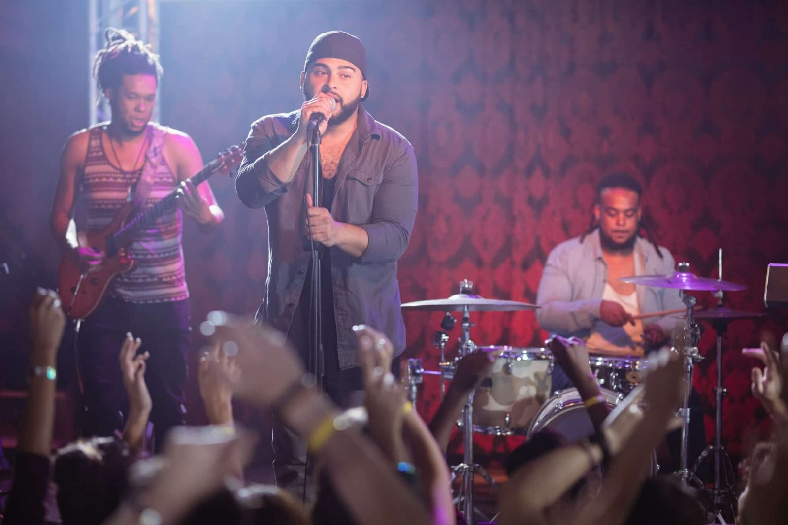 Male musicians performing at nightclub